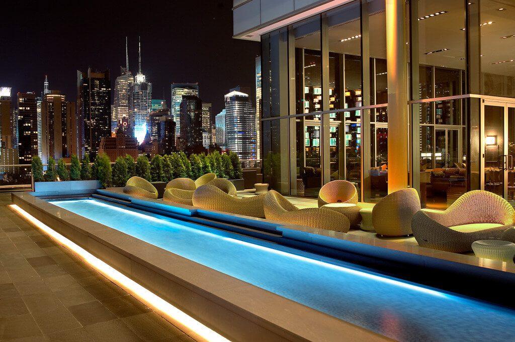 Reflecting pool at night at The Press Lounge.