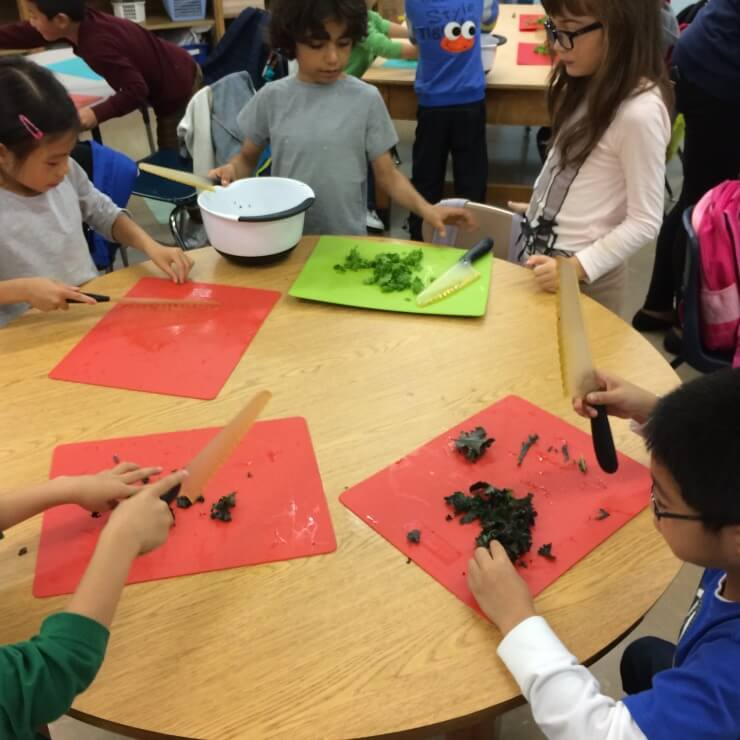 Students chopping kale.