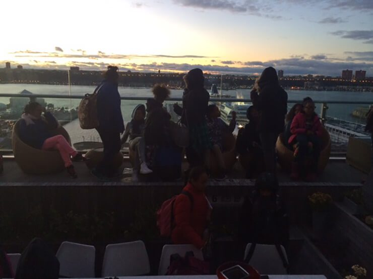 Students in the rooftop garden at sunset.