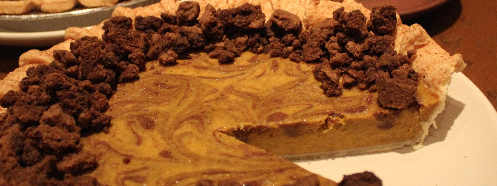 Pumpkin pie with spice crust and cookie butter accent.