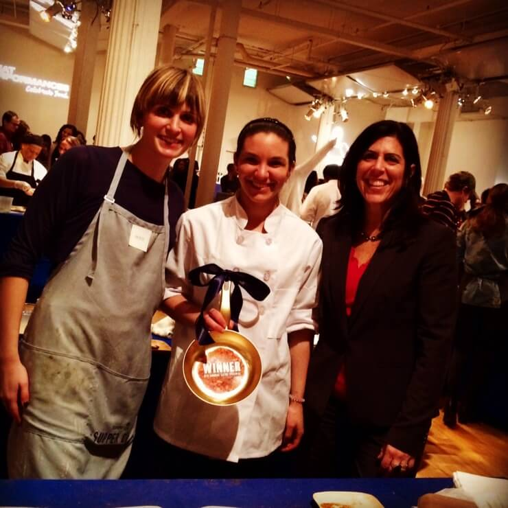 Meghan Boledovich, Wendy Nash, and PRINT chef holding winner frying pan trophy.