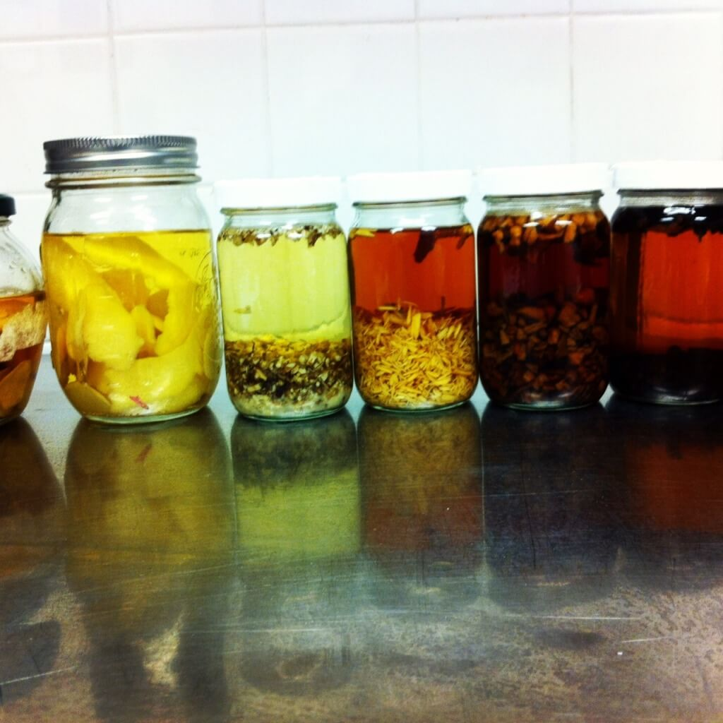 Multiple jars of different infusions.