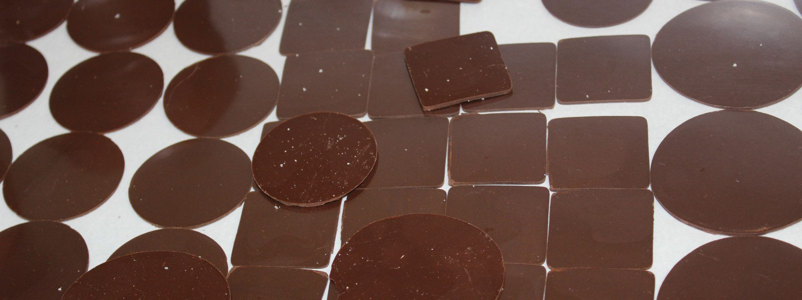 Tempered chocolate squares and discs.