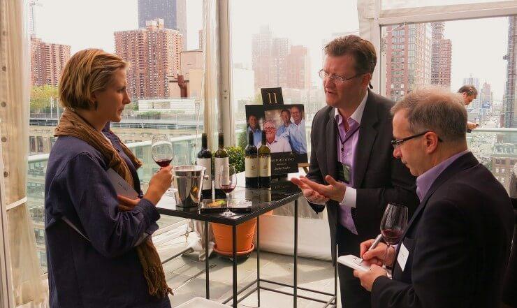 Meghan speaking with winemakers.