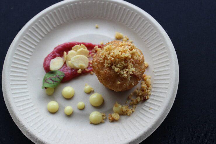 Mini Almond Kougin-Amann with Rhubarb Compote, Lemon Curd, and Sorrel Garnish.