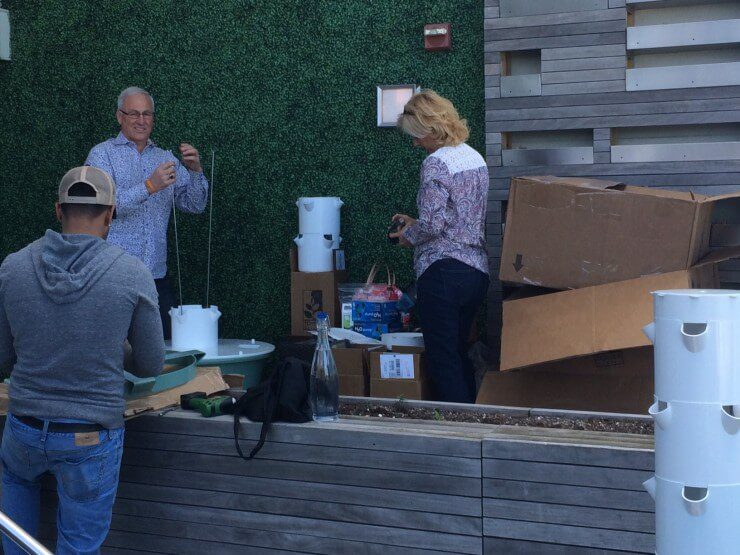 3 people constructing the aeroponic towers in the Rooftop Garden.