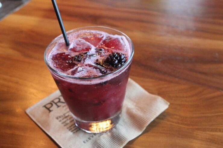 Blackberry cobbler in a rocks glass.