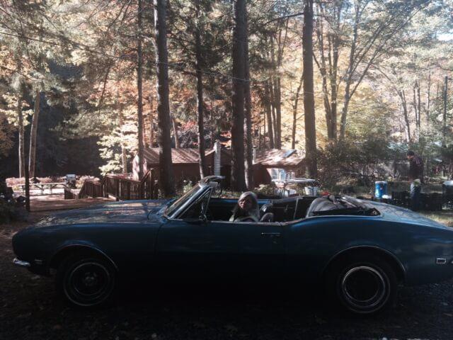 Franca in her blue Camaro.