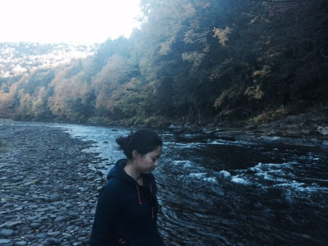 A woman and a river.