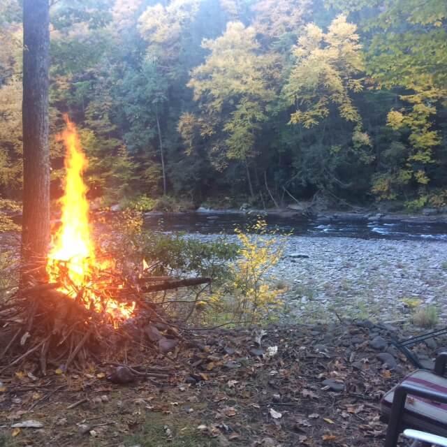 Bonfire next to the river.