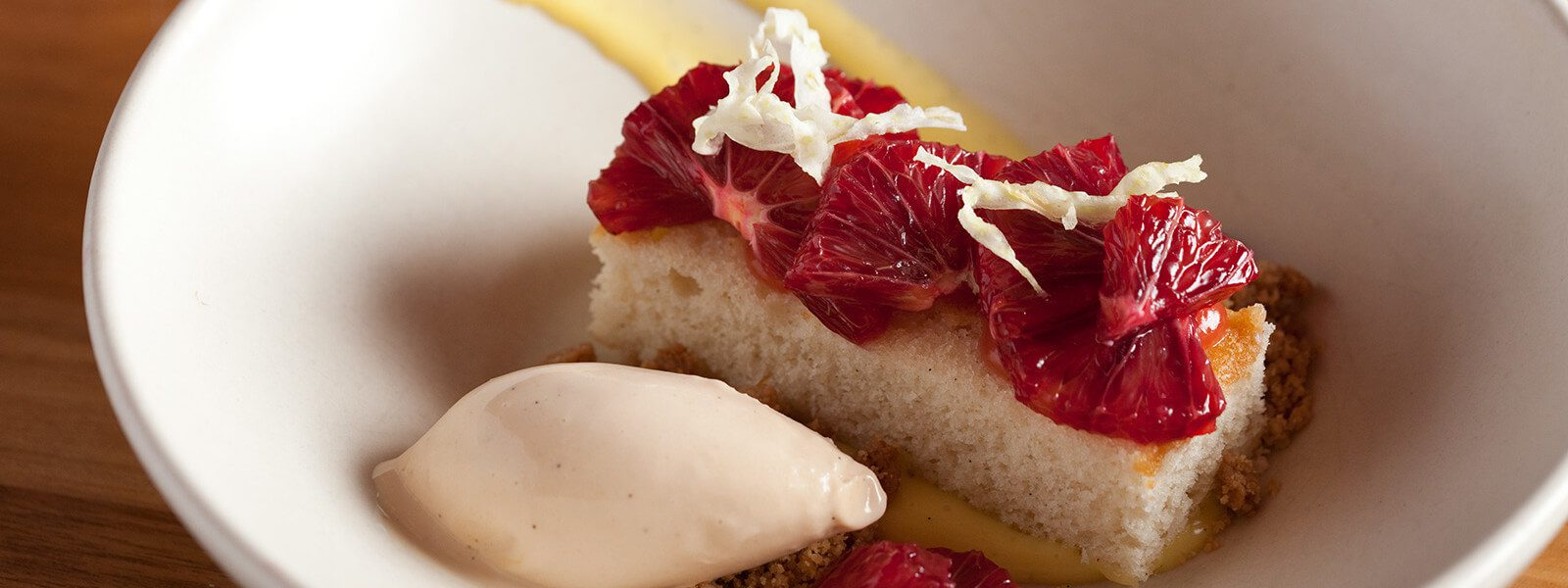 Sponge cake with blood orange and ice cream.