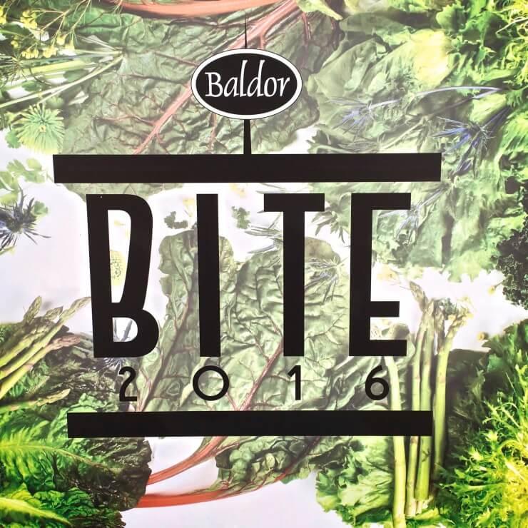 """Baldor Bite 2016"" logo with green vegetables."