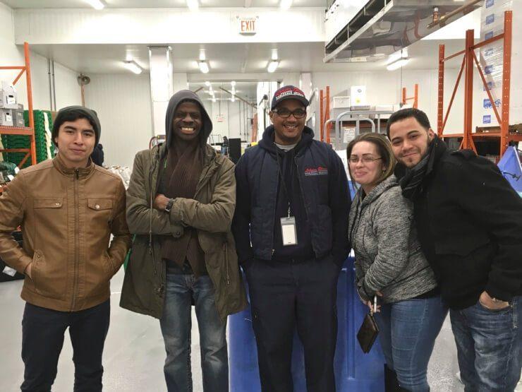 5 PRINT team members posing before tour.