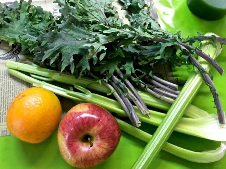 Apple, orange, celery, and kale.