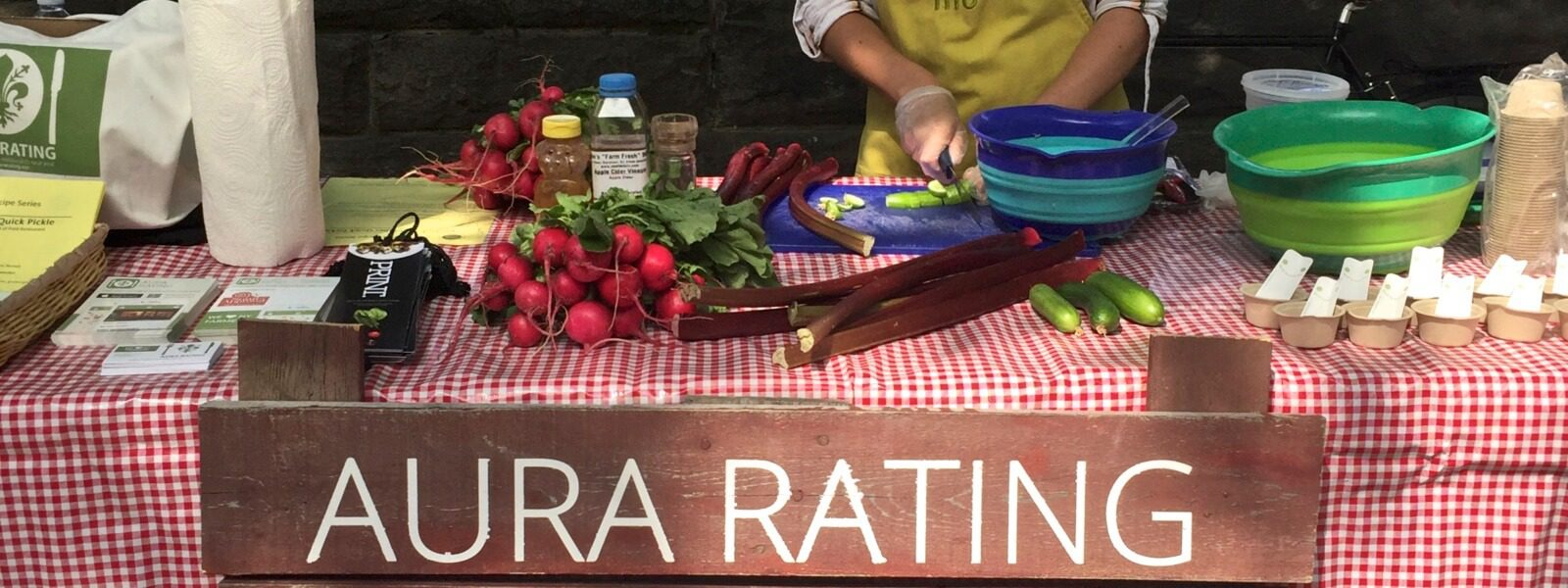 """Table set up with """"Aura Rating"""" sign."""