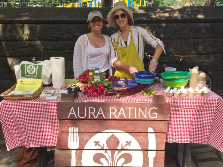 Meghan and team member at table making Rhubarb Cucumber Quick Pickle.