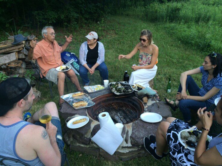 PRINT team and Meadows team enjoying lunch around the fire pit.