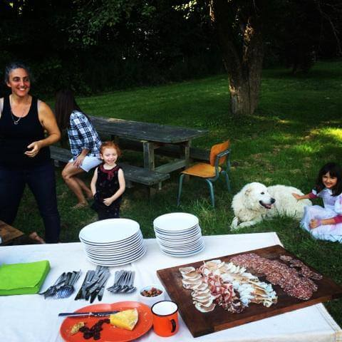 Raven and Boar farm family with dog and charcuterie spread.