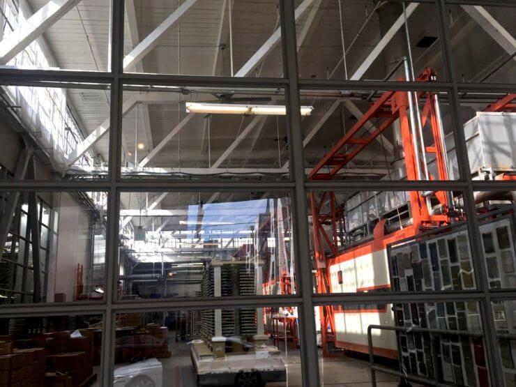 The Heath factory through a window.