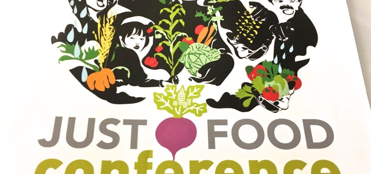 "Sign with text ""Just Food Conference: A Call to Collaboration."""