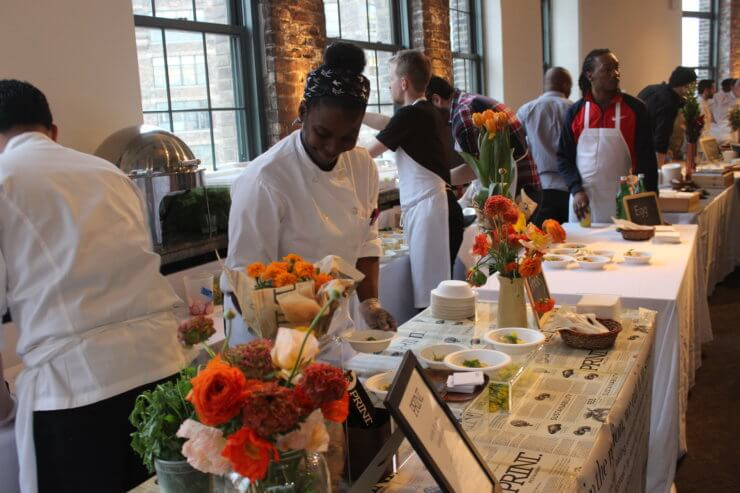 Chefs setting up tables at the Wellness In the Schools gala.