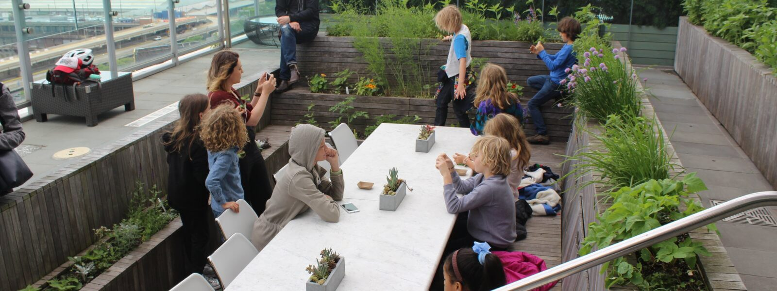 Students from the Blue School at the Press Rooftop Garden Table.