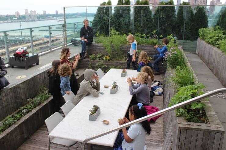 Students at the Rooftop Garden Table.