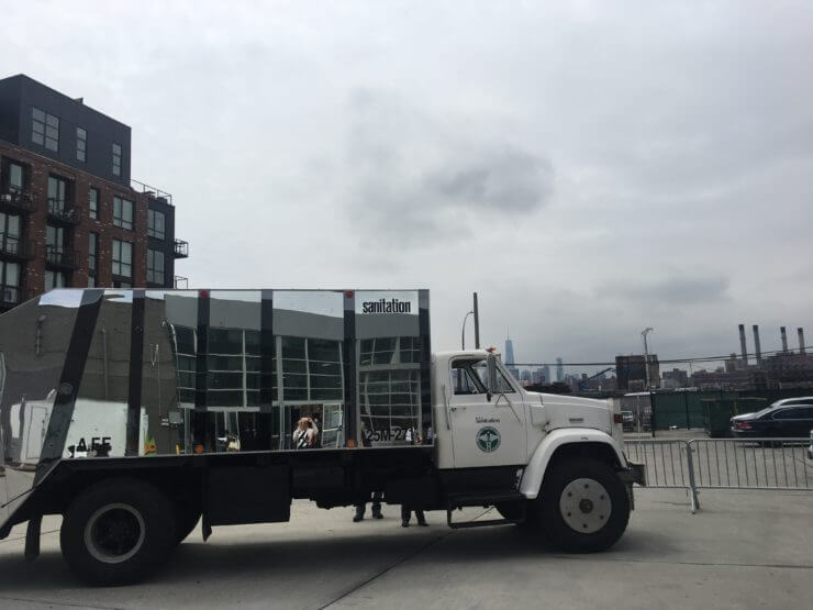 Mirrored sanitation truck.
