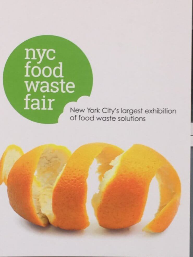 """Sign with text """"NYC food waste fair. New York City's largest exhibition of food waste solutions."""""""