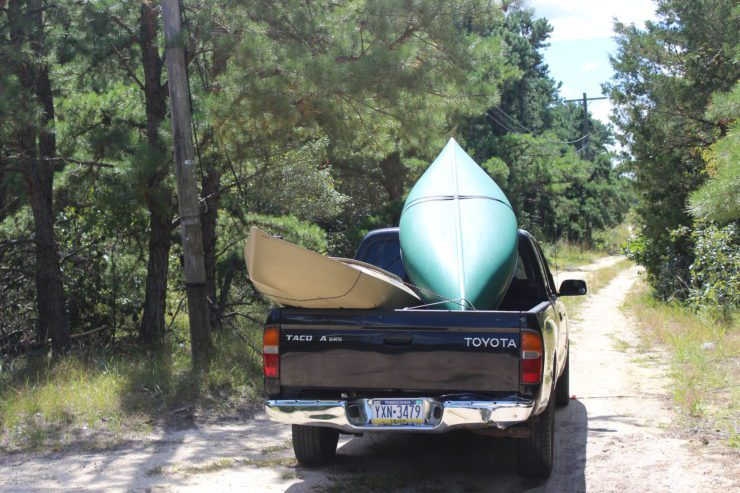 Pickup truck with canoe and kayak.