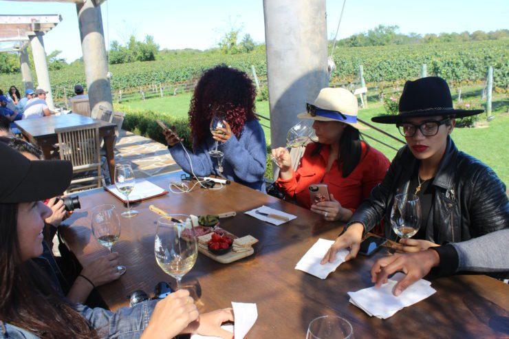 Press staff tasting wines.