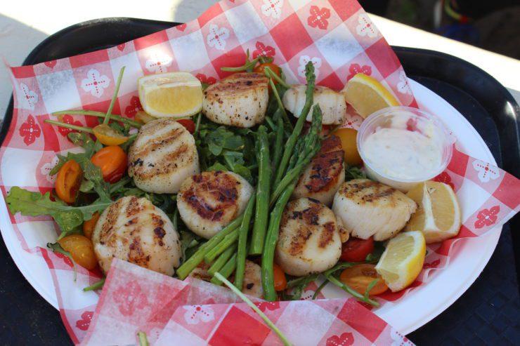 Platter of scallops, asparagus, and lemons.