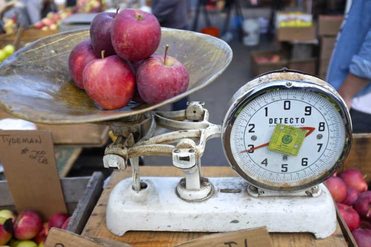 Apples being weighed on a produce scale.