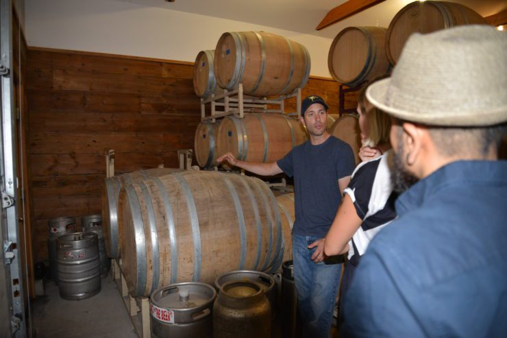 Patrick showing the barrel room.