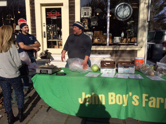 John Boy at John Boy's Farm table with produce.