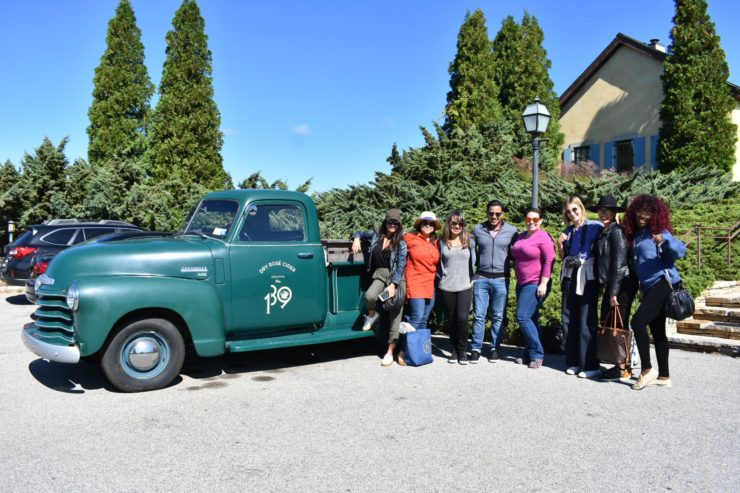 Press staff posing with Wolffer pickup truck.
