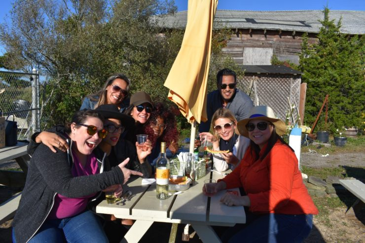Press team enjoying seafood lunch and wine.