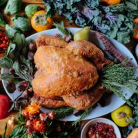 Thanksgiving turkey with herbs and fresh produce.