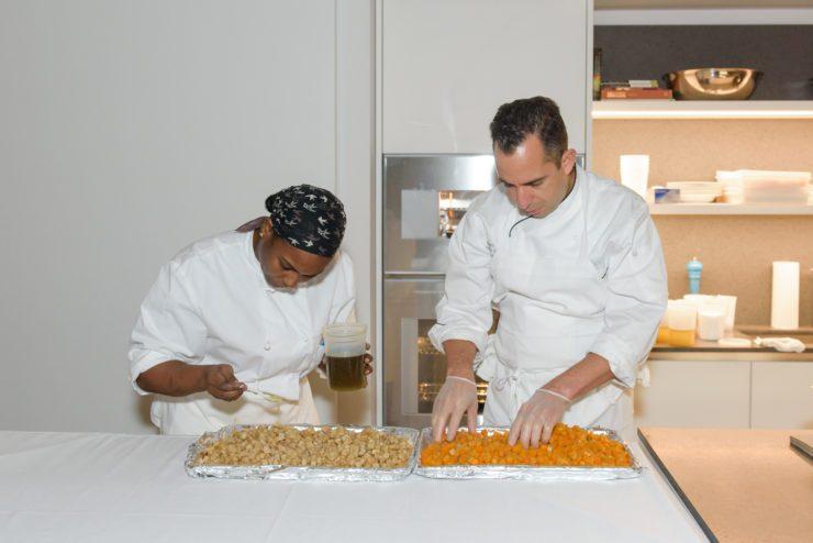 Chef Charles and PRINT team member preparing ingredients.
