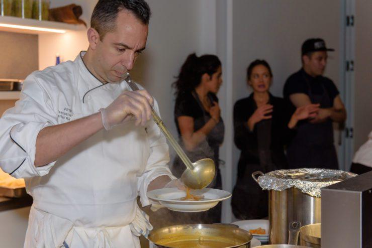 Chef Charles plating his sancocho.