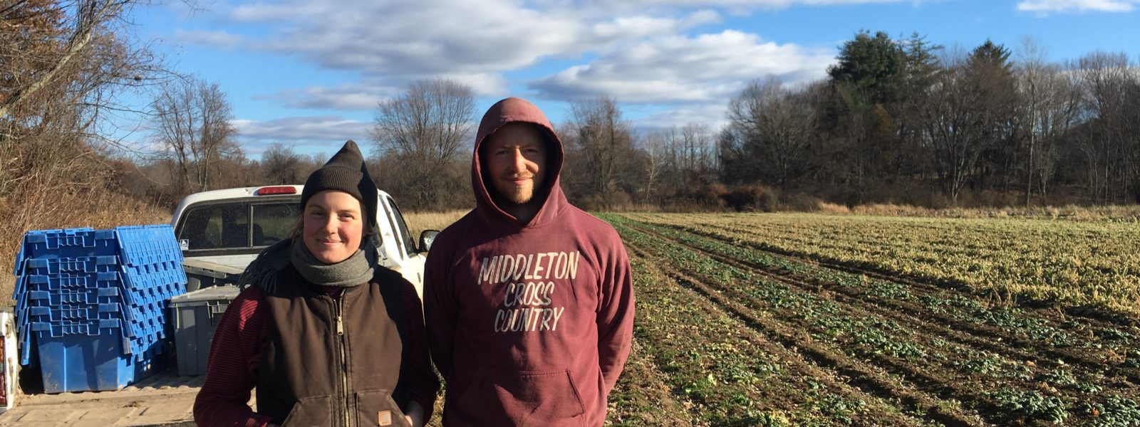 Two Alewife farmers posing in the field.