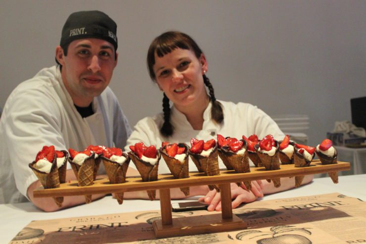 Chefs Brian Del Colle and Amy Hess with waffle cones.