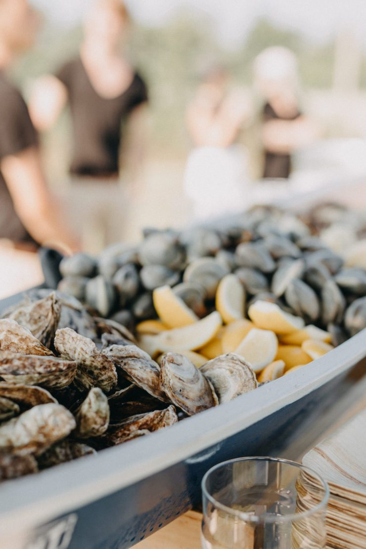 Oysters and clams in a serving dish.
