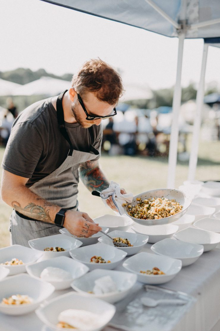 Chef Gary preparing dishes at Dinner in a Field.
