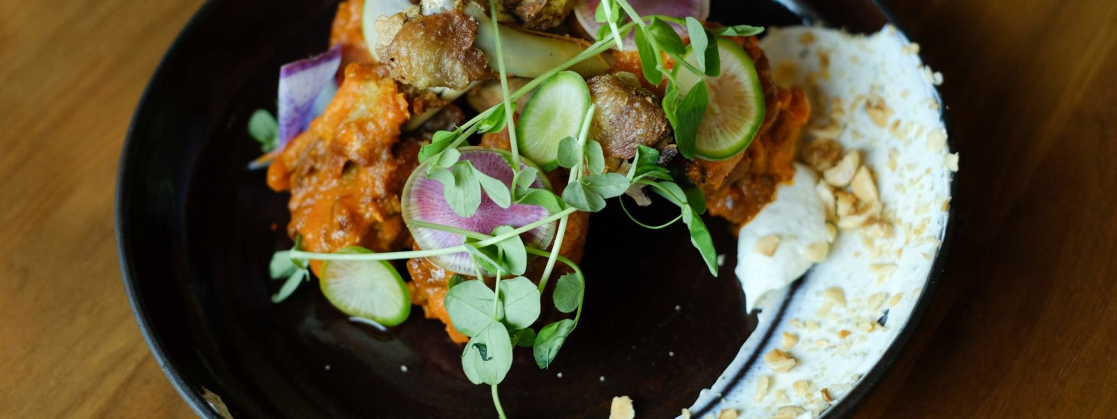 Chicken dish with micro greens, and radishes.