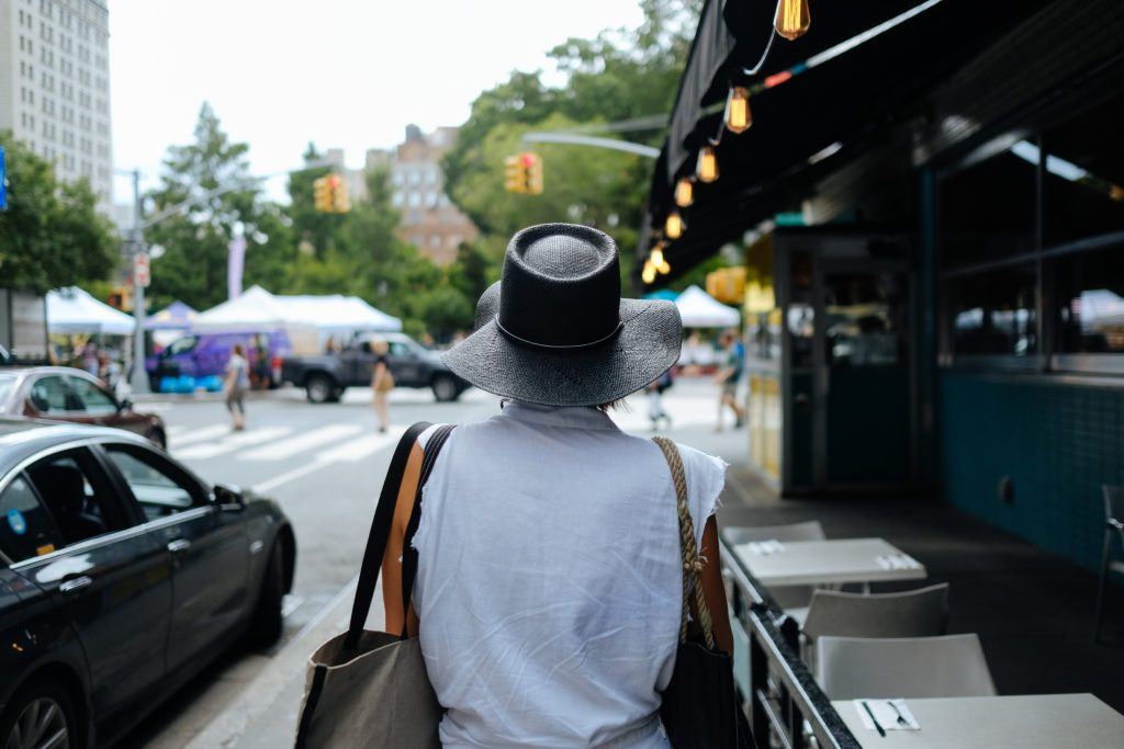 Forager Meghan heading to Union Square Greenmarket in hat.