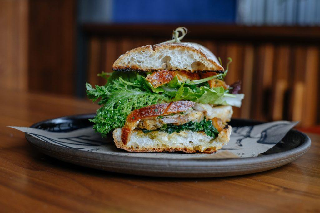 Porchetta sandwich on bun.