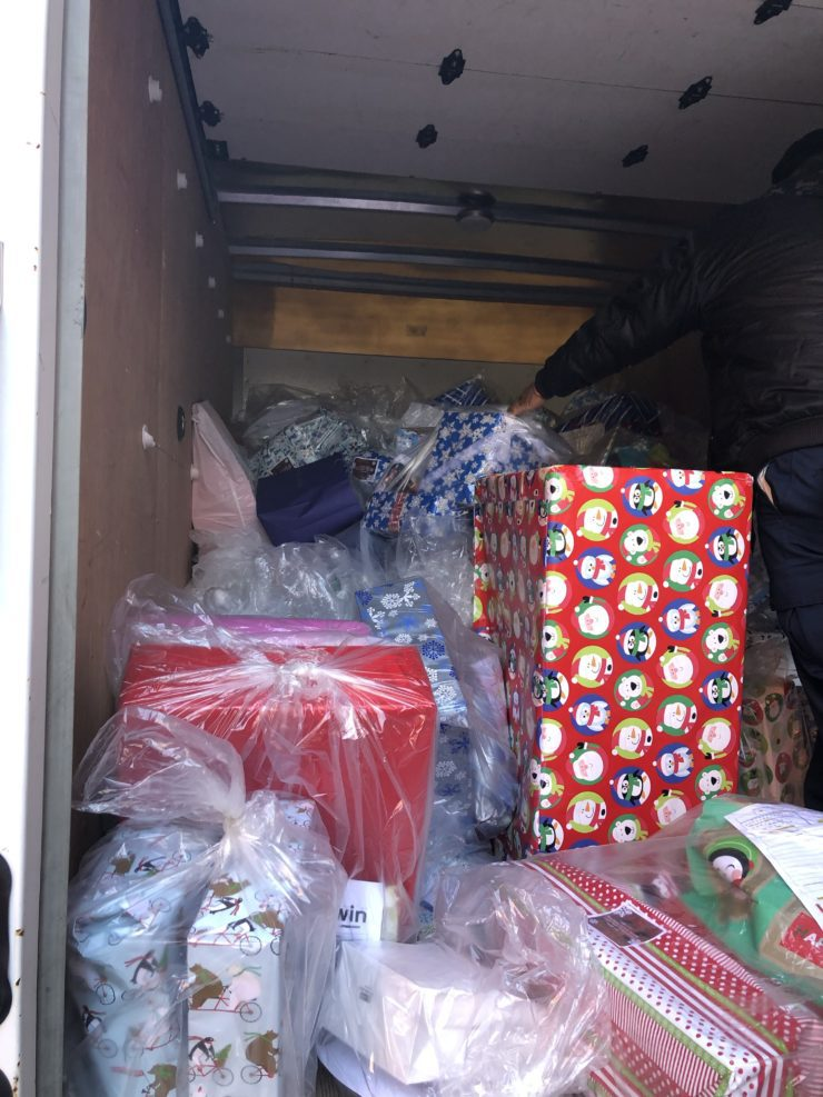 Wrapped gifts in back of truck.