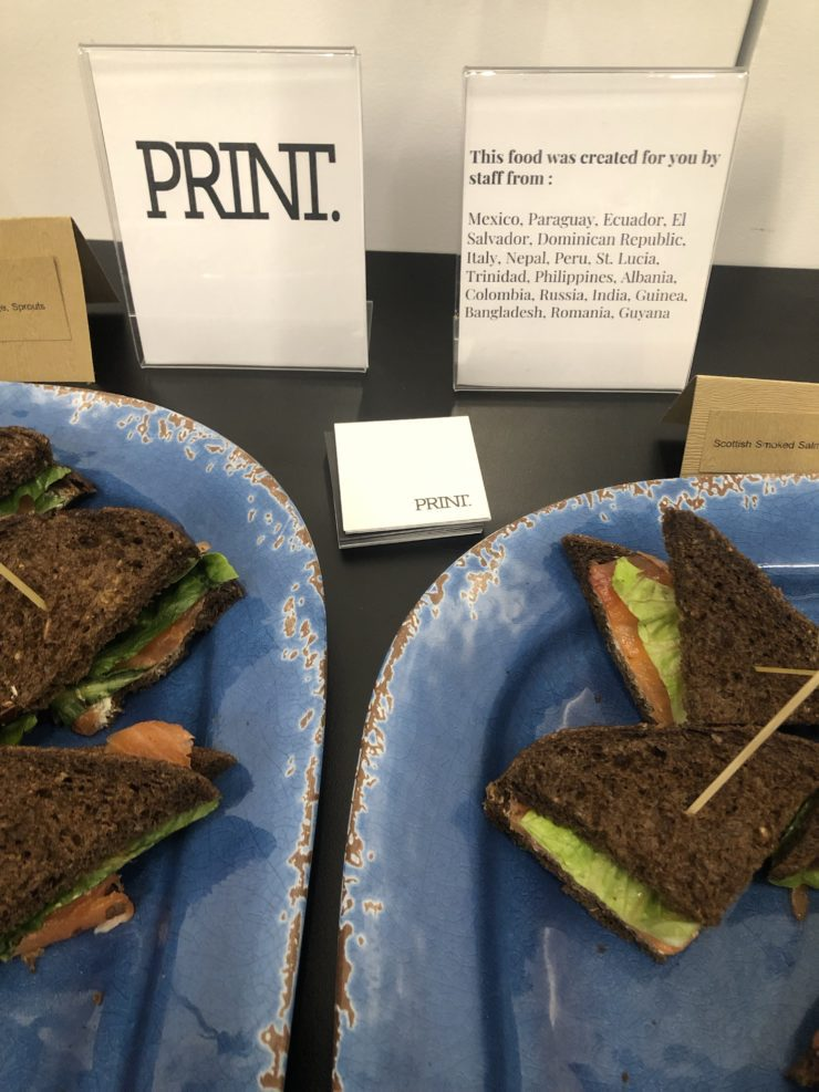 PRINT sandwiches with sign saying the origin countries of the people who provided the food.