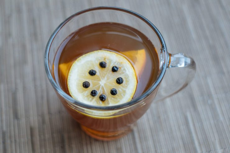Toddy with lemon slice studded with cloves.